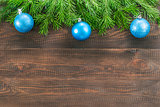 Christmas fir tree with decoration on wooden background