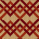 Knitting seamless zigzag pattern in beige and brown