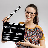 Woman with a clapboard