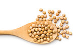 uncooked chickpeas in wooden spoon