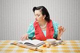 Girl reads a cookbook