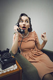 Woman talking on phone, looking surprised
