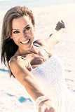 Beautiful Brunette Woman Laughing On A Beach
