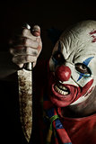 scary evil clown with a knife
