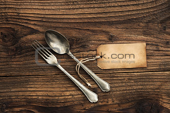 Old fork and spoon with paper label