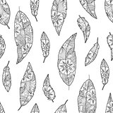 Seamless pattern of bird feathers with ornament inside