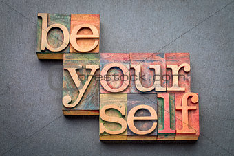 be yourself word abstract in wood type