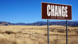 Change Just Ahead brown road sign