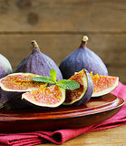 Natural ripe figs on a wooden board