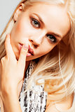 young pretty woman with blond hair on white background, sensual makeup, fashion look