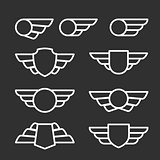 Winged badges and emblems in simple style