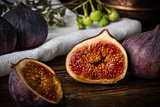 Half ripe and juicy fig lying on rustic table