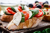 Bruschetta with tomatoes, mozzarella and basil