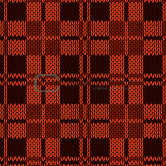 Knitting seamless pattern in various red and brown hues