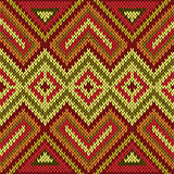 Ornamental knitting seamless pattern in bright warm hues