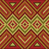 Ornamental knitting seamless pattern in bright warm hues