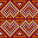 Ethnic knitting seamless pattern in warm hues