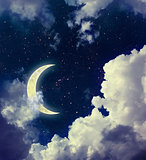 Dark Sky with Clouds, Stars and Crescent Moon