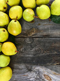 Ripe green pears on gray worn wooden background