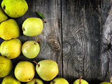 green pears on gray worn wooden background