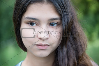 Portrait of beautiful girl looking to the side