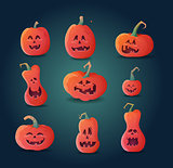 set of pumpkins on a dark background.