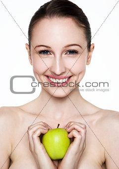 Beautiful fitness woman holding healthy apple