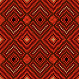 Ornate ethnic knitting seamless pattern in warm hues