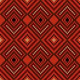 Ornate ethnic knitting seamless pattern in warm hues