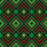 Ornate ethnic knitting seamless pattern mainly in green color