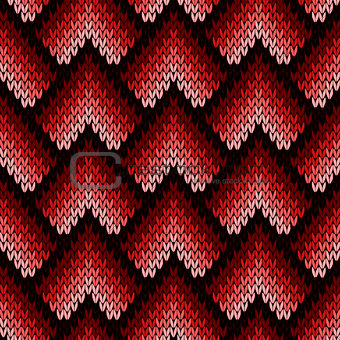 Abstract ornate knitting seamless pattern in red hues