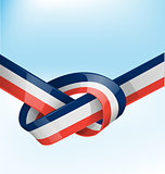 france ribbon flag on bue sky background