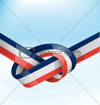 france ribbon flag on bue sky background