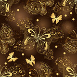Seamless dark brown pattern with gold butterflies