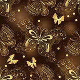 Seamless dark brown pattern with gold butterflies