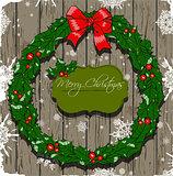 Christmas card with wreath.