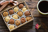 Chocolate truffles and cup of black coffee