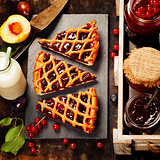 Fruit and berry jam and pieces of fruit tart