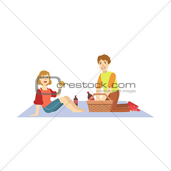 Couple Eating Burgers On Picnic