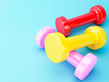 3D colorful dumbbells. Healthy lifestyle concept.