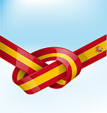 spain ribbon flag on bue sky background