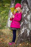 Girl having fun in autumn park
