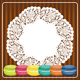 Macarons on lace paper background