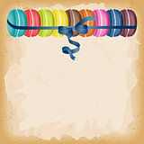 Macarons tied with blue ribbon background