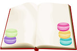 Opened blank book with macarons