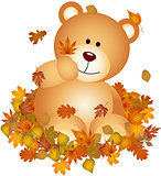 Teddy bears on set fall leaves