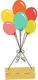 Wooden sign flying with balloons