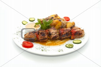 shish kebab and baked potato with dressing
