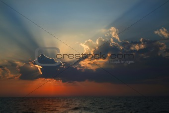 Beams of the sun above the sea.