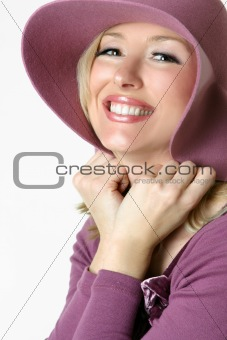 Playful woman in large brimmed sunhat